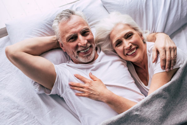 happy elderly couple talking about impotence