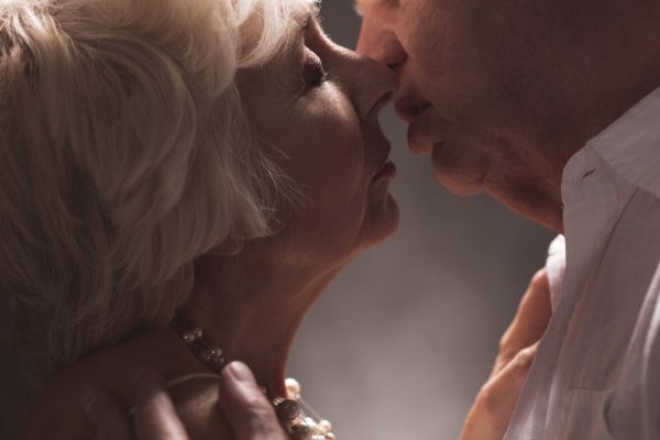 Senior-couple-making-out-in-erotic-embrace
