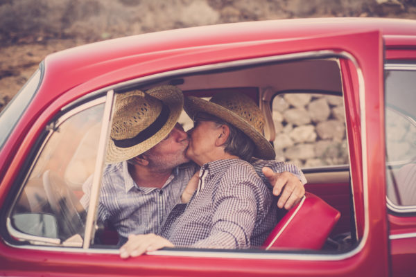 elderly-couple-in-love-kissing-in-car