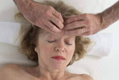 Woman's forehead being lovingly massaged