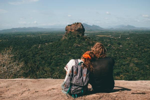Couple looking at expanse, focusing on each other