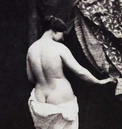 Woman standing with a towel on