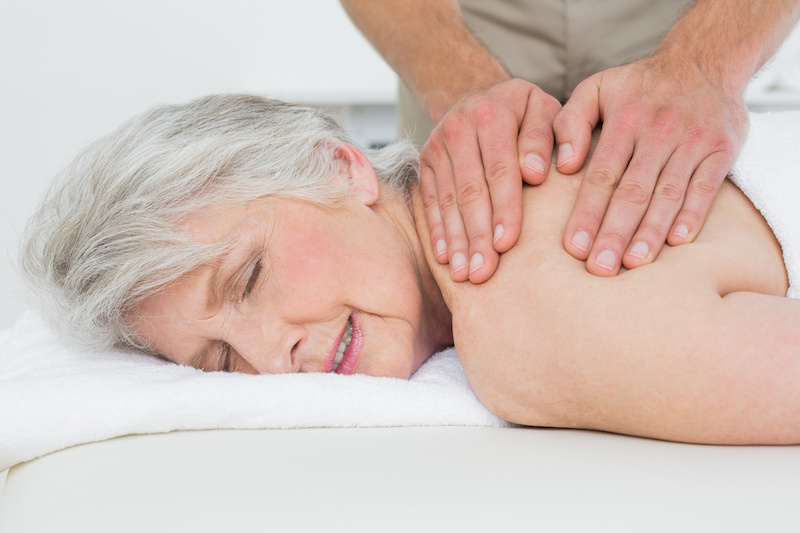 Senior woman relaxes during Loving Massage